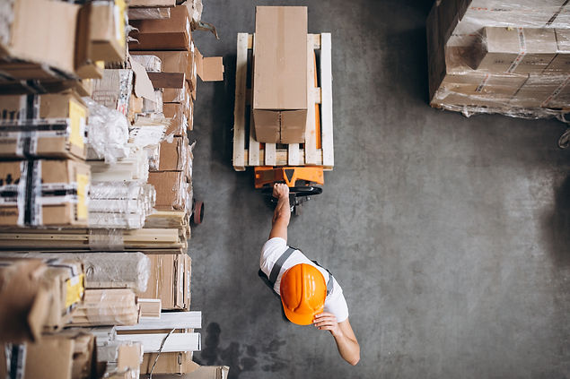 young-man-working-warehouse-with-boxes.jpg