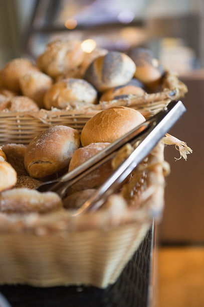 basket-with-fresh-bread-and-tongs-at-the