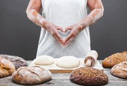 baker-preparing-delicious-fresh-bread-an