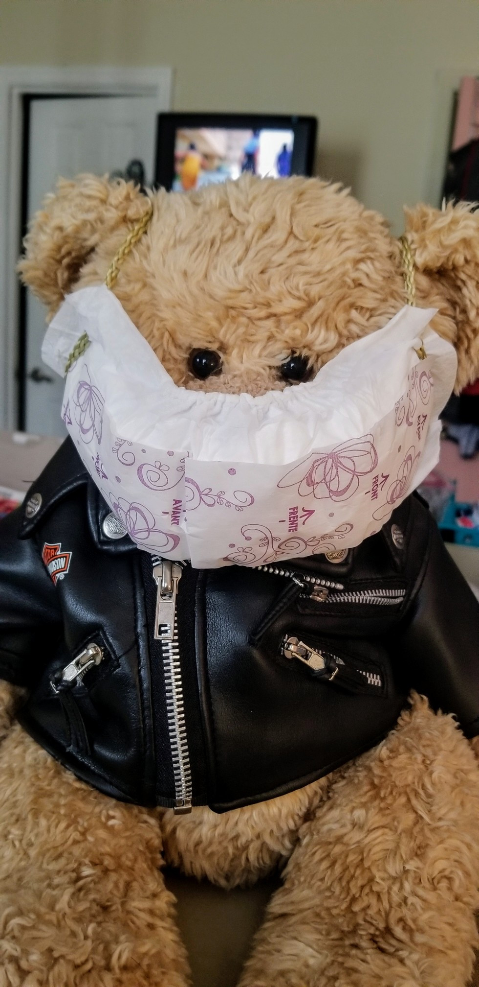 """Either from boredom or ingenuity, my mother devised a """"mask"""" from a Poise pantyliner and strapped it to MY teddybear...."""