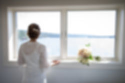 Bride looking out the window before the