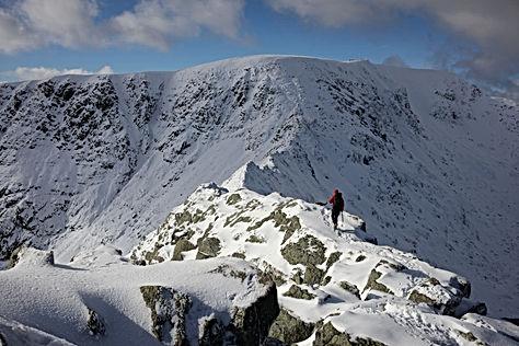 Winter on Striding Edge. Climber crossin