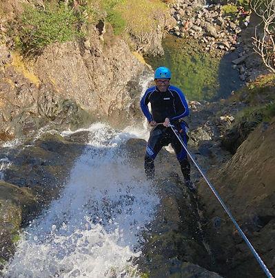 Waterfall abseil in Langdale
