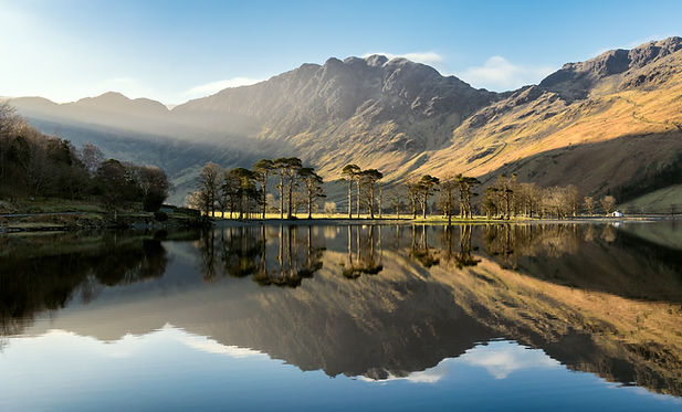 Beautiful morning sunlight shining on Buttermere - guided walking with Lake District Mountaineering