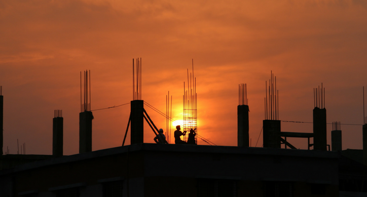Sunset on building side for BCIPA article Aitchison Reid