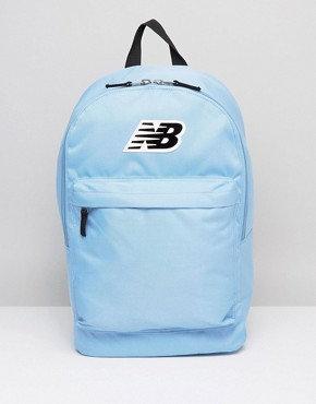 Голубой рюкзак от New balance. Большой черный лейбл сверху.