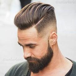 man met baard en fade kortgeschoren haren. Medavita idol men