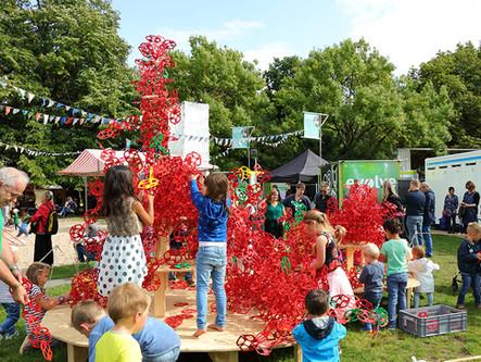 Citizens at festival in Groningen inspired by building blocks illustrating evolution
