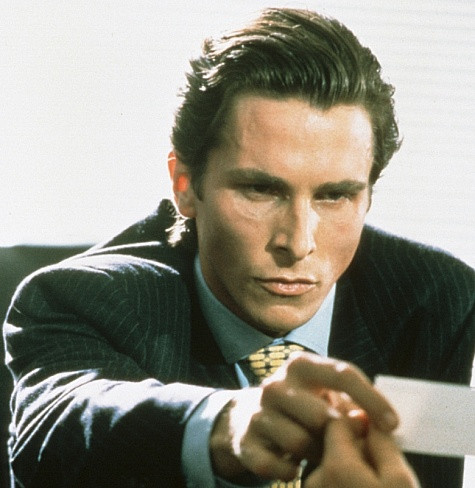 Patrick Bateman (Christian Bale), reaches for business card - A Classic Review