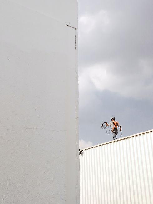 man-walking-on-roof-top-2317640.jpg