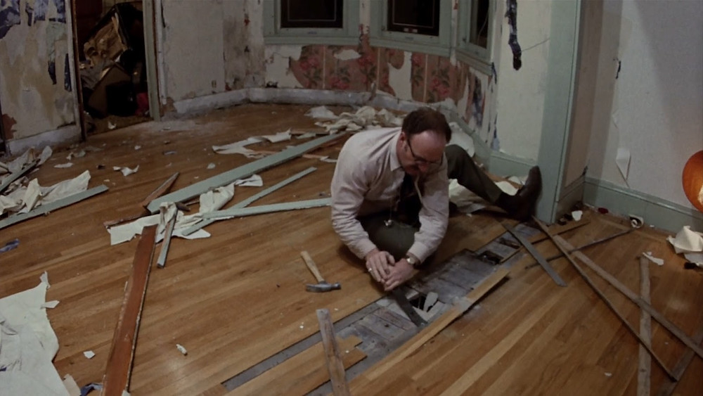 long shot of Gene Hackman tearing up the floor of his apartment - A Classic Review
