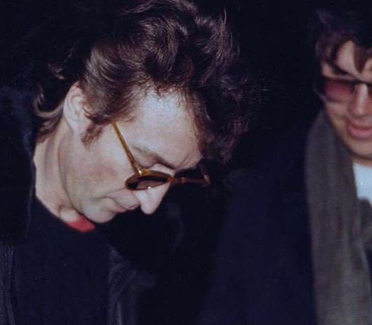 Lennon signs album, Chapman watches - A Classic Review