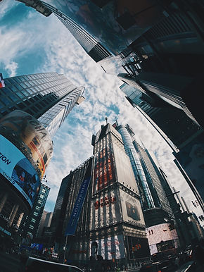 low-angle-photograph-of-city-structures-
