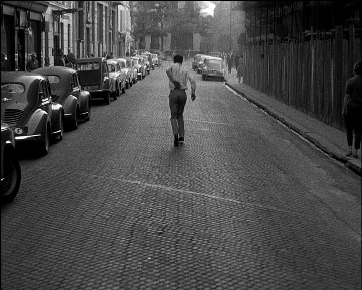 Jean-Paul Belmondo, wounded walking on street - A Classic Review