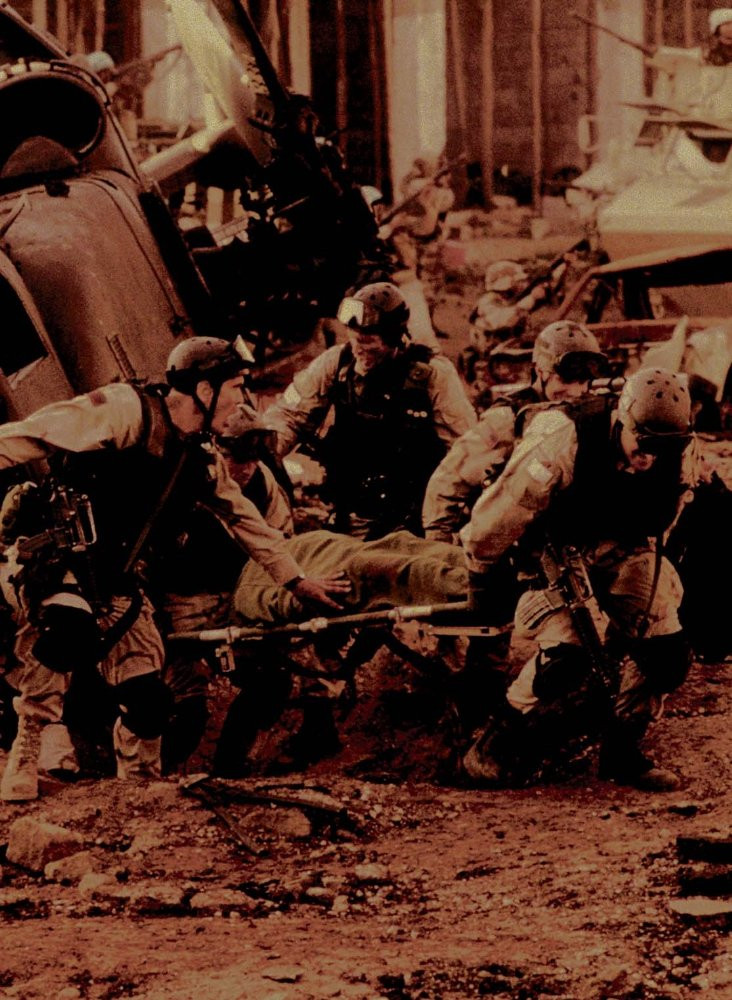 Mrines assisting wounded warrior - A Classic Review