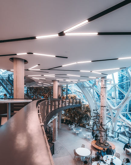 people-walking-inside-building-with-glas