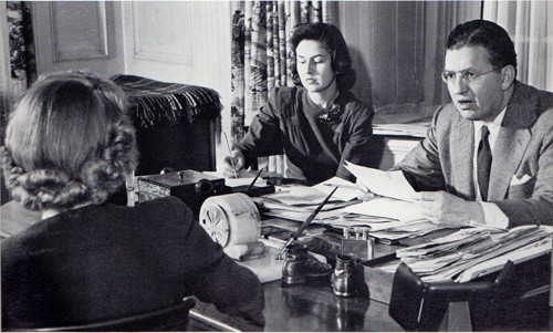 David Selznick, behind desk