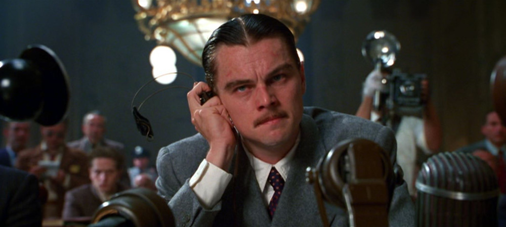 Dicaprio behind mikes, testifying - A Classic Review