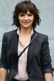 Juliette Binoche, medium shot, gray man's jacket - A Classic Review