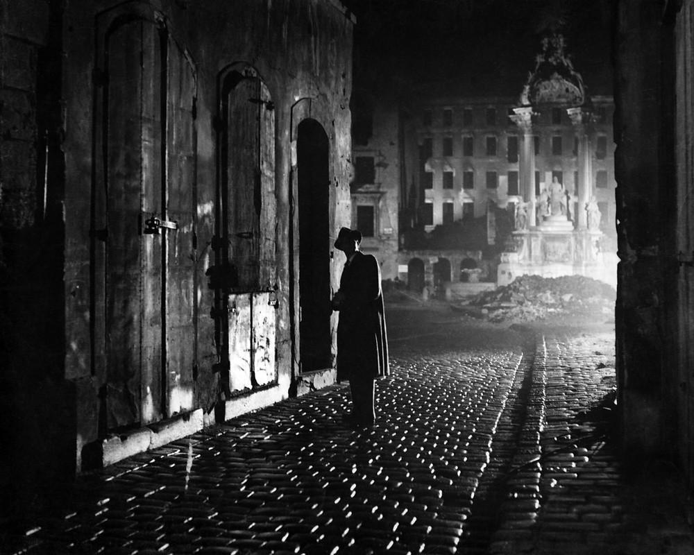 night, man on cobblestone street