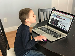 Child learning magic online in a virtual setting