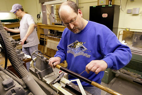 Jeff Mrocztk attaches leather wrapping to a cue at McDermott Cue Manufacturing in Menomonee Falls. Wisconsin produces more high-end pool cues than any other state.