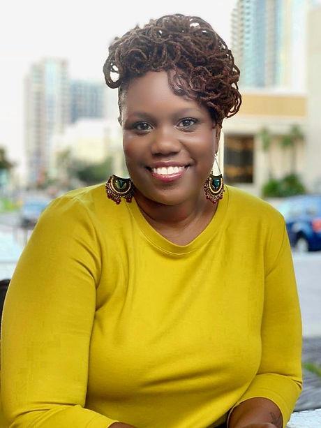 Durham Aisha Bio Photo Yellow.jpg