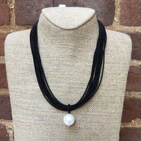 Sea Lily Black Piano Wire Necklace with Mother of Pearl Drop