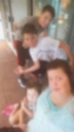 mom and kids in rain