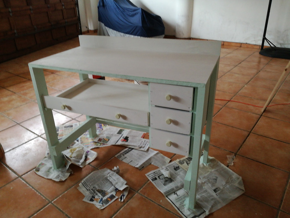 Picture of my minty-green jeweler's bench I made to being learning jewelry making.
