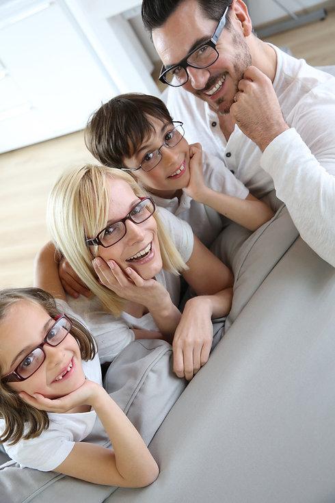 Family of four wearing eyeglasses.jpg