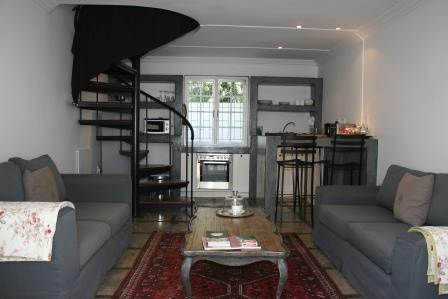 lounge and kitchen with winding staircas