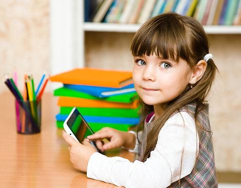little girl using tablet computer. looki