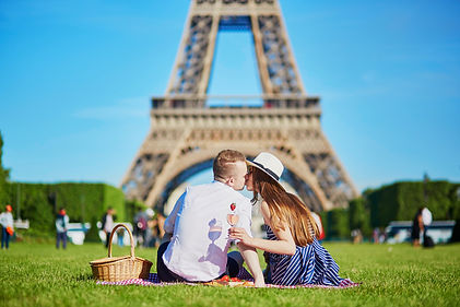 Couple Having Picnic Near The Eiffel Tow