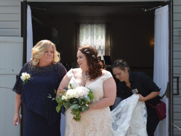 Kaitlin assisting a Bride with her Train