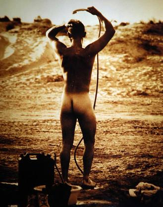 Gulf War soldier showers in the desert