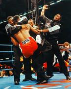 Lennox Lewis wins his WBC Heaveyweight title defense against Frank Bruno