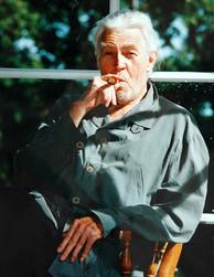 Hollywood actor James Coburn taking a break during filming