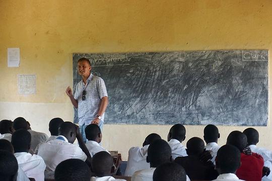 Clark Varin teaching in Uganda