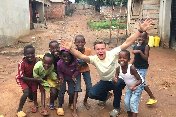 Clark Varin with kids in Uganda