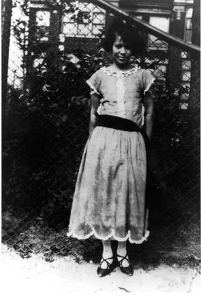 Young Zora Neale Hurston, outdoors. Lean