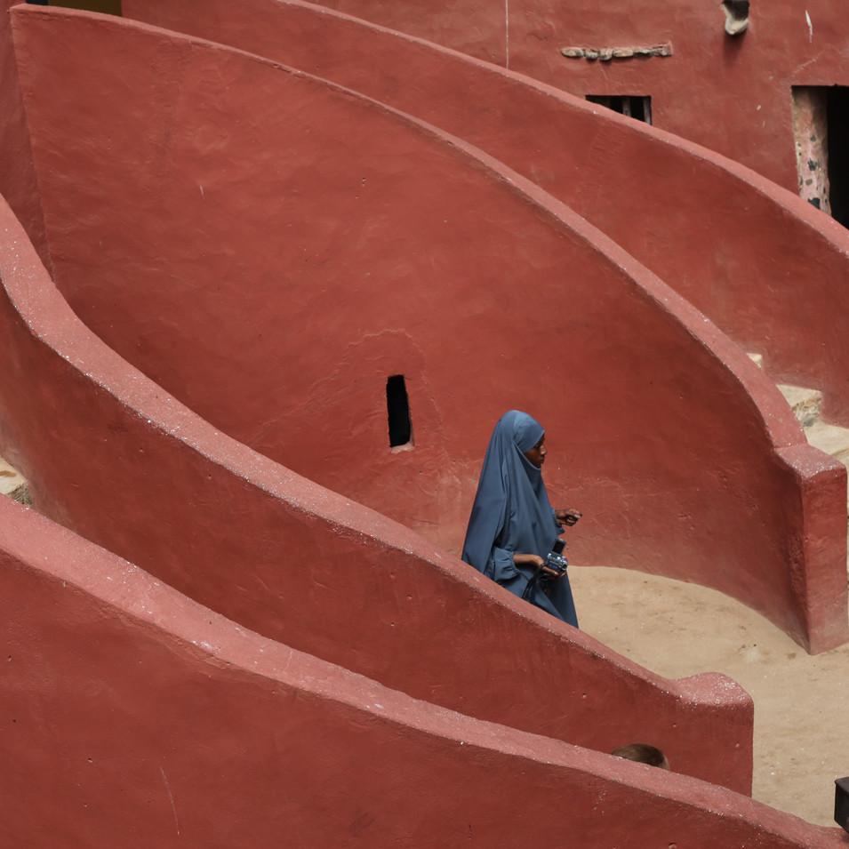 Woman in Blue at Maison des Esclaves