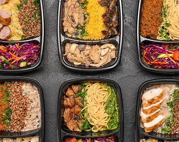 Containers with healthy food on dark bac