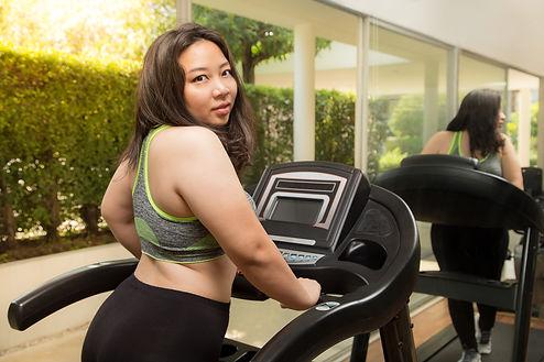 Fat Woman weight loss running on treadmi