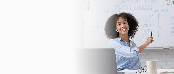 teacher at computer and whiteboard-kip.p