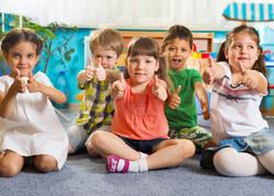 children-kindergarten-thumbs-up