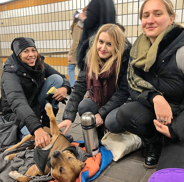 Hot Choc Mob volunteers with rough sleeper's dog making hot drinks for the homeless in London