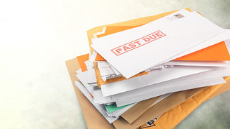 Pile of envelopes with overdue utility b