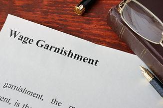Wage Garnishment definition written on a