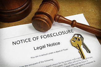 Foreclosure document with house keys and